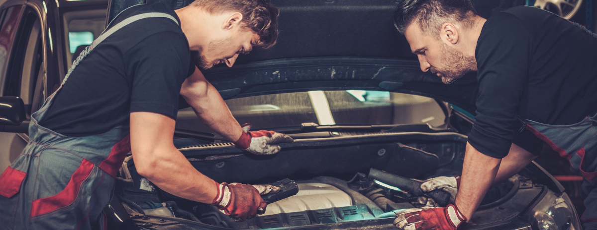 Mechanics doing a service on a vehicle - Car Servicing in Kirkcudbright